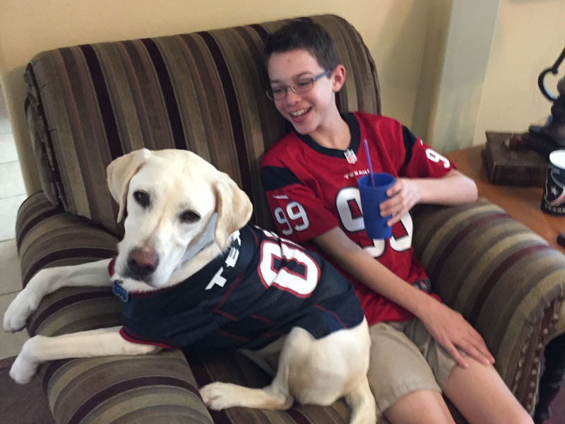 Steven with his Autism Service Dog, Akela.