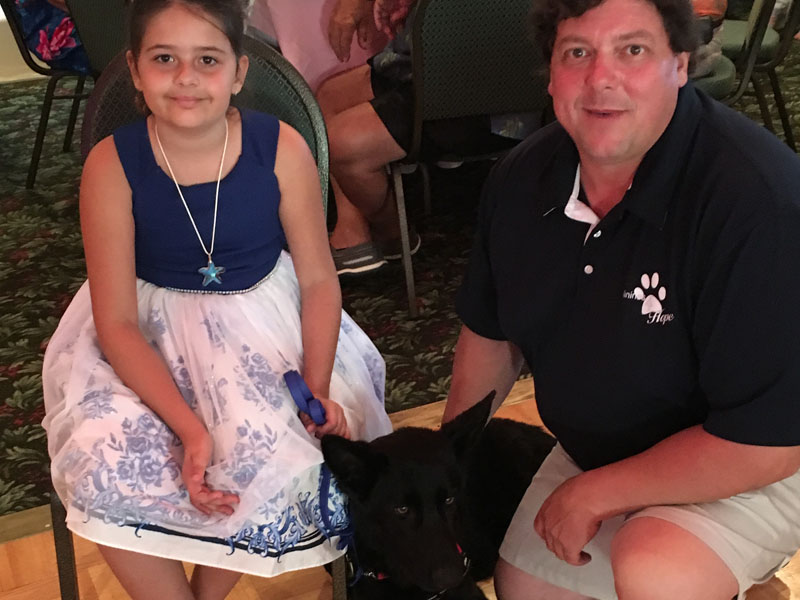 Kali with her Seizure Service Repsonse Dog, Titan and Canines 4 Hope Owner and Service Dog Trainer, Jason DeVito.