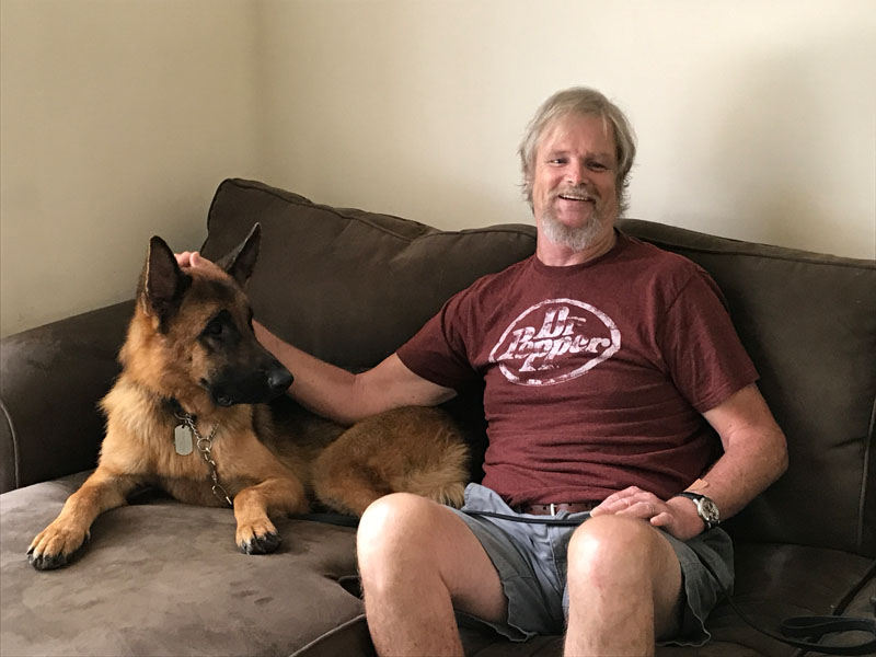 Jim with his Seizure Response Dog, Sparticus.