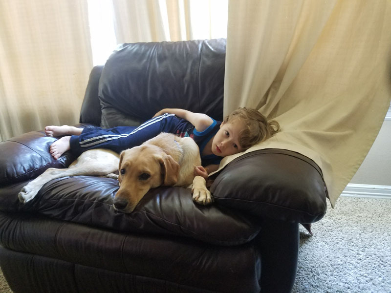 Emmet with his Autism Service Dog, Sage.