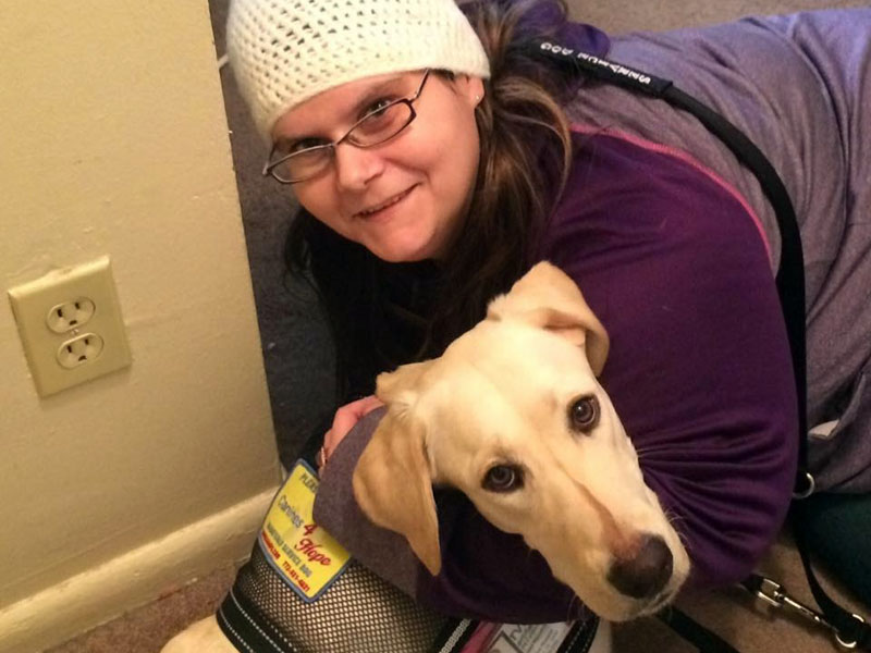 Jessica with her Service Dog Skye.